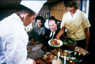 A chef serving food at a DC-8