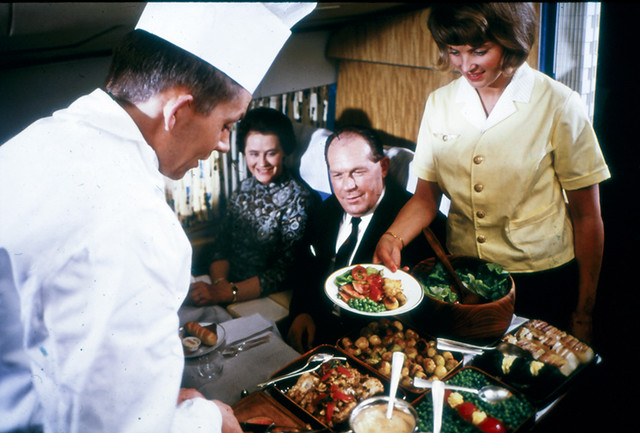 A chef serving food at a DC-8