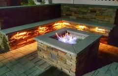 Perfect night for some family & friends. www.stonecreationsoflongisland.net #masonry #outdoorliving #custom #stonework #gasfirepit #hardscapes #landscapedesigns #homeimprovements #landscapelighting #cambridgepavers #nyc #brooklyn #queens #nassaucounty