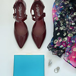 Burgundy pointed heels, blue clutch and patterned dress
