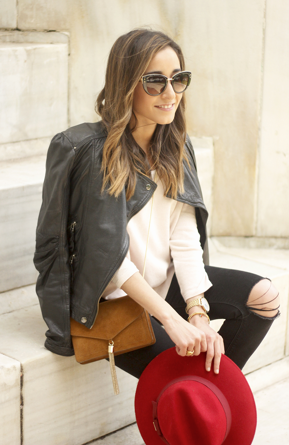 black biker jacket ripped jeans red hat camel bag outfit fashion style spring10