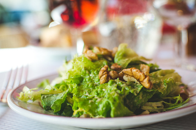 Meals at Relais de l'Entrecôte begin with a light salad topped with a mustardy vinaigrette and a small handful of walnuts.