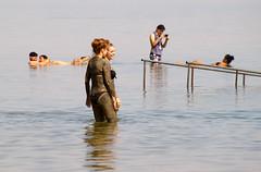 Two girls covered in mud, Ein Bokek Beach, the Dead Sea, Israel