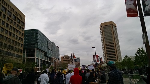 Protesters march past Harborplace and the Inner Harbor