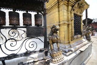 Prayer wheels and sculptures around the stupa - Swayambhunath