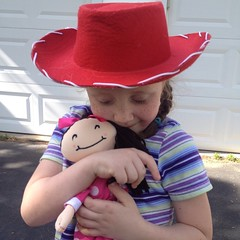 This is how she went to her Daisy Scout meeting tonight.  Yes, I let her wear it. I am her cow mom. LOL. #jesse #toystory #dollfromdance #dancesong #red #cowboyhat #outofthemouthsofbabes