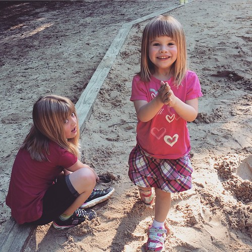 Sisters in the sandbox.