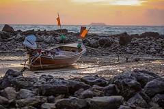 Long-tail fishing boat stranded by high tides at sunset on Koh Lanta Yai Island, Thailand #travel #thailand #amazingthailand #sunset