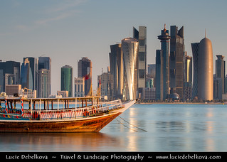 Qatar - Doha - Modern Skyline with Sky High Skyscrapers along the Corniche and traditional Dhow