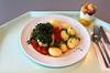 Poached coalfish on tomatoes with leaf spinach / Gedünsteter Seelachs im Tomatenbett mit Blattspinat
