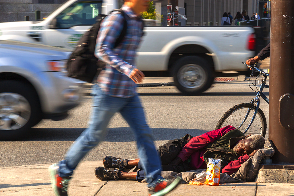 Old man sleeping on sidewalk at 30th and Market on 4-26-16--University City