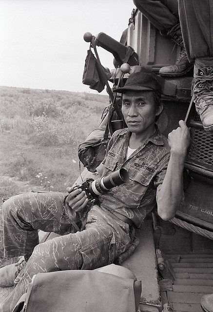 1973 - Willie Vicoy, UPI Photographer, shown leaning against a vehicle, in Vietnam