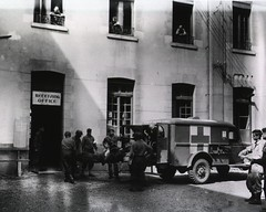 A wounded American soldier is taken from an ambulance into the receiving room of a hospital in France