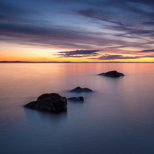 longexposure sunset blur reflection rock night suomi finland evening moody cloudy dramatic tampere kivi auringonlasku näsijärvi kauppi ndgrad pitkävalotus