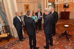 U.S. Secretary of State John Kerry chats with NATO Secretary General Jens Stoltenberg before their working dinner at the U.S. Department of State in Washington, D.C., on May 27, 2015. [State Department photo/ Public Domain]