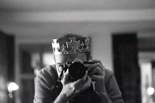 reflected self-portrait with Nikon FM2 camera and crown