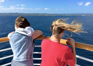 Alex and Susie staring towards Jamaica