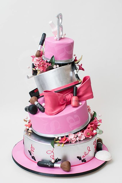 A party cake for a lucky girl would not be complete without a bright pink bow by Ron Ben-Israel Cakes
