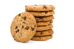 Pile of chocolate chip cookies isolated on white b…