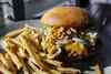 Burger w/ Bacon Slaw, Fried Leeks, Jalapeno, and Cheddar - Table 9