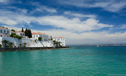 blue sea summer sky white clouds island greek gulf hellas greece spetses spetsai argosaronikos