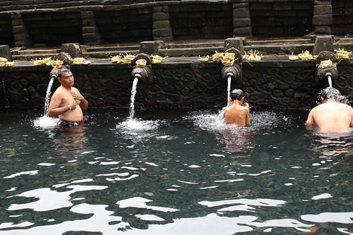 Balinese men bathing in the holy water at Tirta Empul