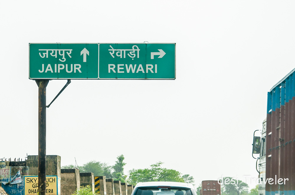 signboards to Jaipur on NH 8 road to Neemrana