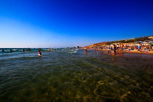 travel sea sky people beach water weather canon israel telaviv seascapes north sigma wideangle bluesky bathing canondslr greatweather ultrawideangle sigma1020 telavivbeach canon600d travelinisrael canont3i canonkiss5 watertransparency bathingintheseatelavivnorthbeach