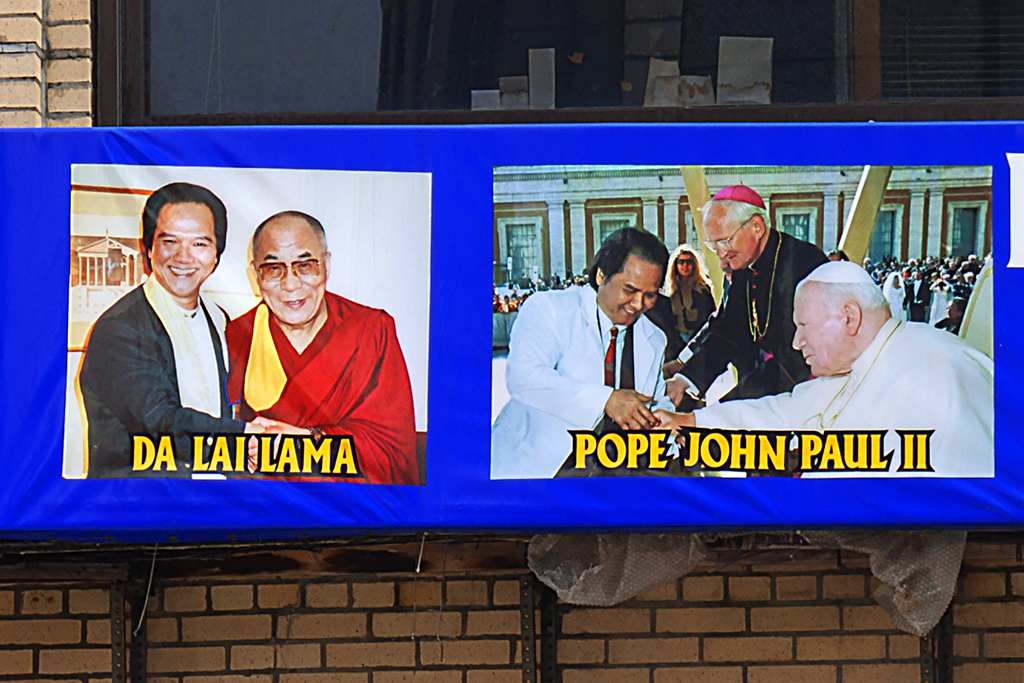 Vietnamese doctor with three Popes and the Dalai Lama--Chinatown (detail)