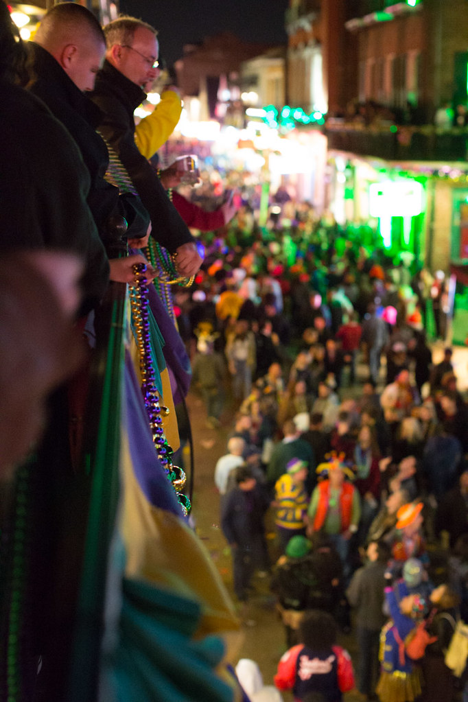 Throwing beads during Mardi Gras