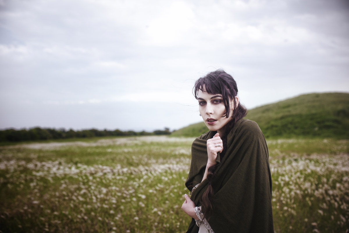 Gestalta photographed by Akiomi Kuroda. Windswept woman with intense gaze, wrapped in a shawl