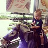 Hyvee checker decided Evan looked like he needed a pony token. No arguments from this guy! #growingupcomo