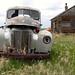International Harvester truck  and farm building.  Montana
