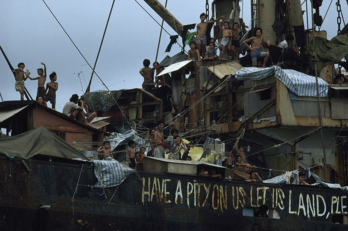 Off the Coast of Hong Kong 1979 - Ethnic Chinese refugees flee from Vietnam on an overcrowded freighter