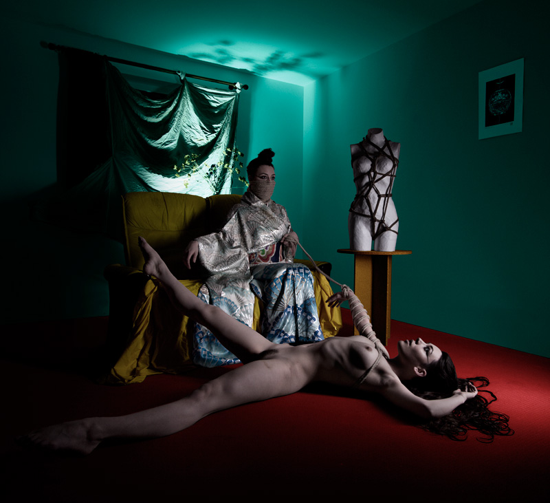 Self portrait by Gestalta. Surreal picture of nude woman tied by a woman wearing kimono
