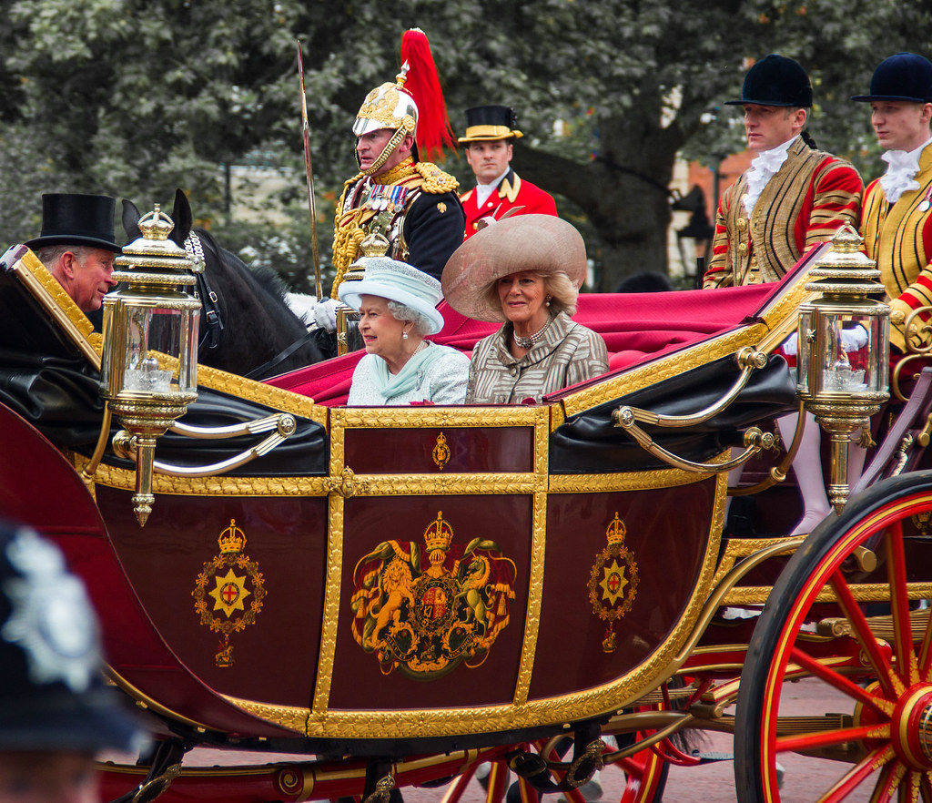The Queen, along with the Duke and Duchess of Cornwall, rides in the 1902 State Landau during a procession as part of the celebrations of her Diamond Jubilee, 2012. Credit Ben