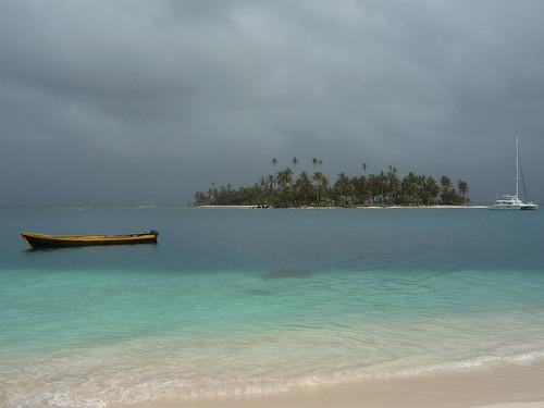 Local Kuna boat and luxurious Catamaran