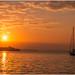 sunrise and a boat by Sukmayadi