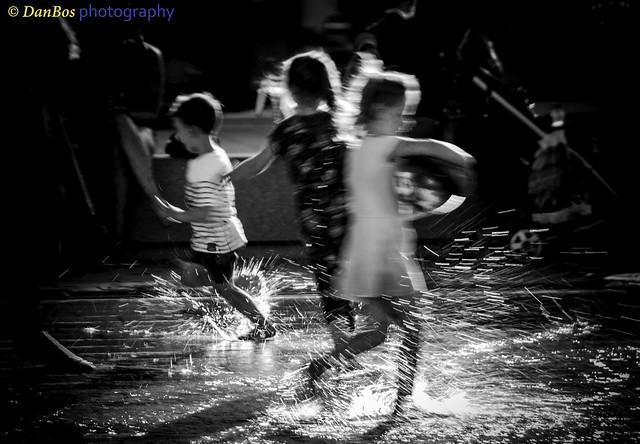 Happy water games - freshness and pleasure running on the water of the fountain