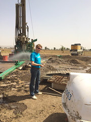 Samuel Godfrey checks soil samples to advice the level of the deep well to access aquifers.