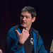 Danny Woodall (Sixense) gesturing with thumb at SVVR 2015 VR Input Panel (closeup, from stomach up)