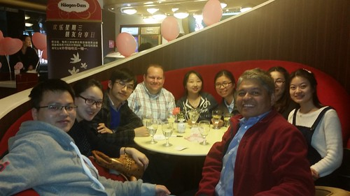 Professors Rigoberto Lopez (in the red jacket) and Adam Rabinowitz (in the plaid shirt) enjoying Haagen-Dazs ice cream ARE alumni in Beijing on March 18th.
