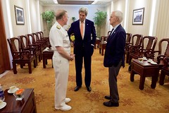 U.S. Secretary of State John Kerry speaks with U.S. Navy Vice Admiral Frank Pandolfe - Assistant to the Chairman of the Joint Chiefs of Staff - and former U.S. Senator and Navy SEAL Bob Kerrey on May 25, 2016, at the Rex Hotel in Ho Chi Minh City, Vietnam, before a ceremony to mark the licensing of the U.S.-supported Fulbright University Vietnam, of which Kerrey will serve as Chairman of the Board of Trustees. [State Department photo/ Public Domain]