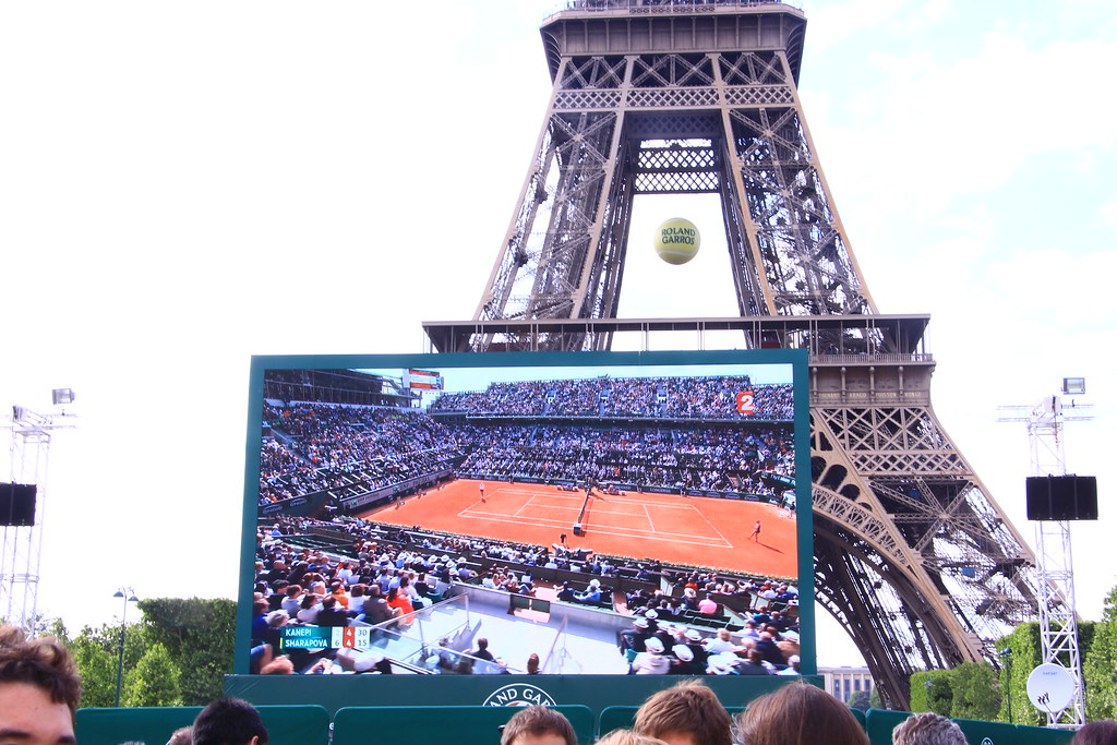 The big screen showing Roland Garros tennis, by the Eiffel Tower
