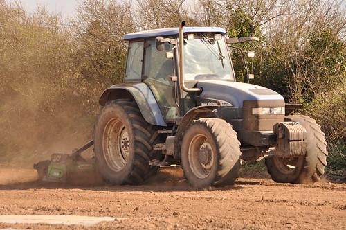 New Holland TM120 Tractor with a Terra Anova Power Harrow