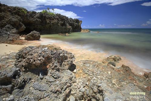travel sea seascape beach water rock landscape outdoors island landscapes rocks seascapes outdoor cove philippines tropical seashore pangasinan waterscape rockformation dasol cabacungan balasnagtaros