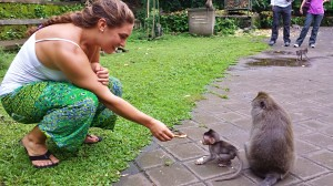 Trying to feed a baby Monkey before it's momma protectively snatched him up!
