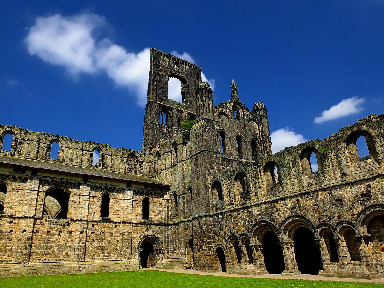 Kirkstall Abbey cloisters. Credit Sireuk