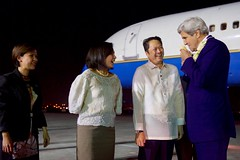 U.S. Secretary of State John Kerry smells a traditional lei presented to him by Filipino Protocol officials on July 26, 2016, at Villamor Airport in Manila, Philippines, after he arrived for a visit that will include meetings with newly elected President Rodrigo Duterte and Foreign Secretary Perfecto Yasay. [State Department Photo/ Public Domain]