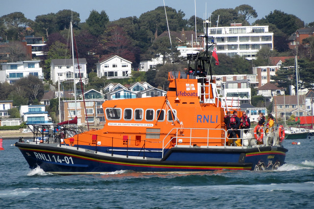 RNLI Lifeboat passing Brownsea Island